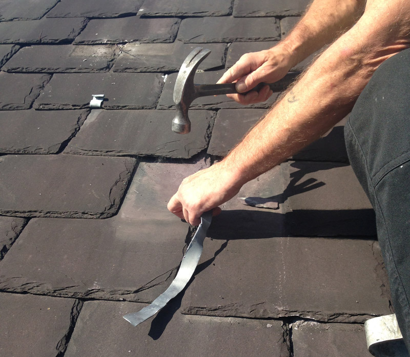 Lead tab on slate repair