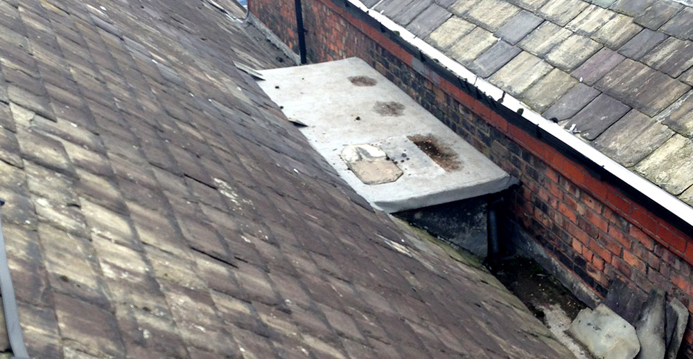 Defunct dormer roof extruding into leaking gulley
